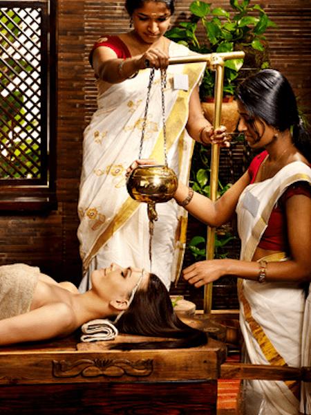 Young woman having Ayurvedic spa massage treatment
